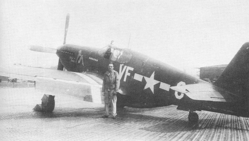 Crew chief S/Sgt Louis Moore stands in front of his and Lt. Fred Glover's P-51 Mustang