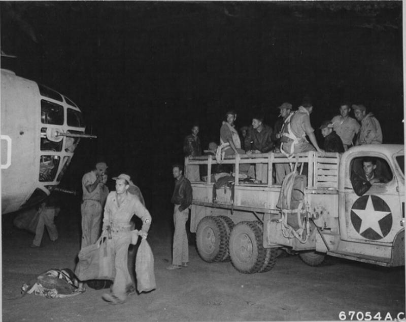 Crew bus disgorges the crew of B-24 Liberator #4240664 'Teggie Ann' 'Honey Chile' 515th BS, 376th BG, 9th AF a participant of the 1st Aug Ploesti raid.