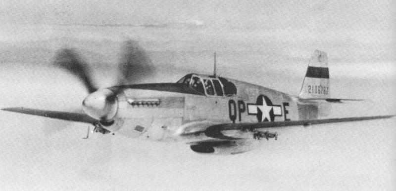North American P-51B Mustang QP-E, Serial No. 42-106767, flown by Lt. Herbert J. Blanchfield was one of the first natural metal finish Mustangs to join the 4th Fighter Group in May 1944. On 9 May 1944, Lt. Blanchfield was shot down in this aircraft and became a POW.