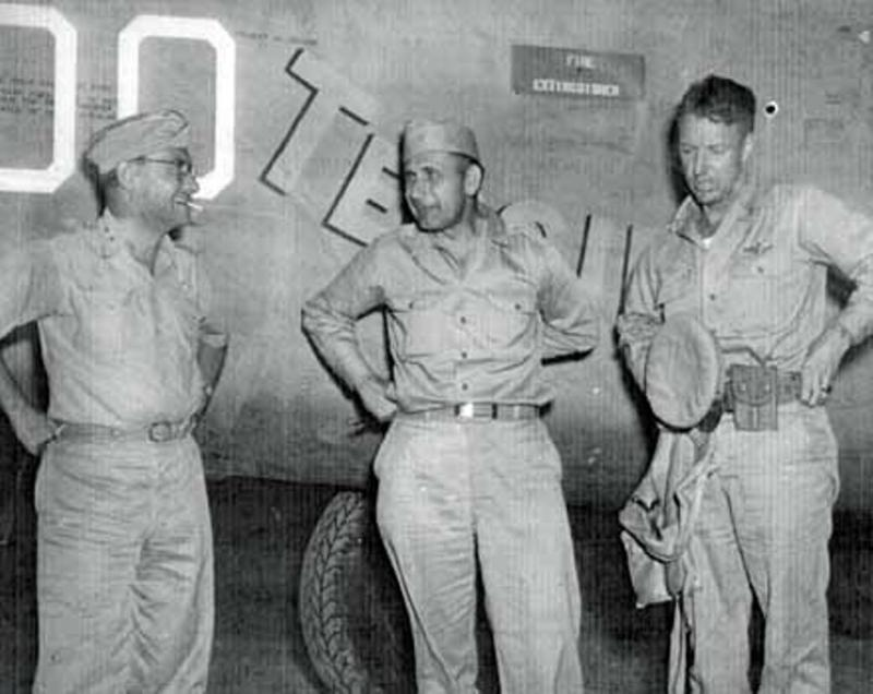 Commanding Officers of the 9th U.S. Air force at a base near Benghazi. Libya after the devastating raid on the Ploesti oil fields. Left to right Maj Gen Lewis Brereton, CG 9th AF; Brig Gen U. G. Ent, CG 9th Bomber Command; and Col K.K. Compton, CO of 376th BG. A/C is B-24 Liberator #4240664 'Teggie Ann'.