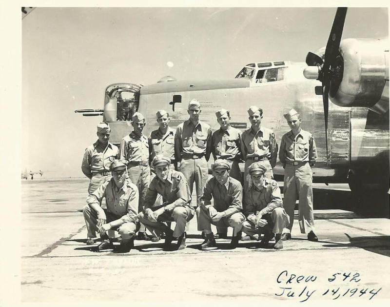 Crew #552 Harry Taylor Crew 466th BG - 785th BS  Standing Left to Right:  Vernal D. Dupas (BTG), William Eastman (R/O), W.W. Flack (WG), Al Wilson (TTG), Jerome R. Krzewinski (TG), Byron C. Wertz (FE), Harry Siders (WG)  Kneeling Left to Right:  Arden D. Mills (CP), Gordon Cuneo (N), Harry W. Taylor (P), Lauren E. Sanborn (B)  Vernal Dupas was not with the Taylor Crew at Attlebridge as he had suffered a burst eardrum just before deployment.  This photo was taken 14 July 1944 at Topeka AAF, Kansas.