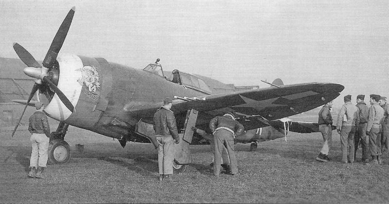 Groundcrew survey the landing gear of P-47C 'WELA KAHAO!'. Assigned to 1st Lts. Stanley Anderson and Walter 'Lulu' Hollander of the 334th Fighter Squadron, the Thunderbolt's art was created by prolific 4th Fighter Group crew chief Don Allen to honour Hollander's Honolulu, Hawaii, home, but the pilot was transferred to the 6th Fighter Wing before he could fly any missions in this particular aircraft.