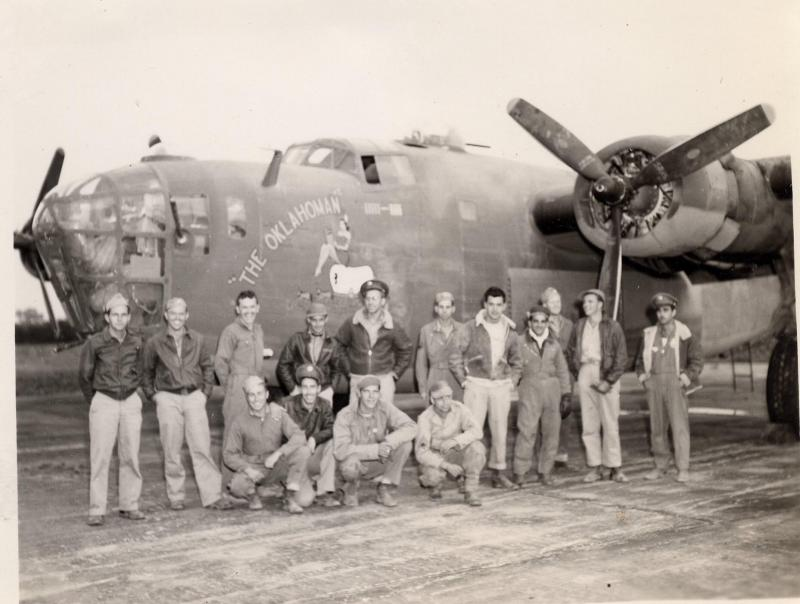 B-24D Liberator, SN # 42-40738,  'The Oklahoman',  in the 566th Bomb Squadron, the 389th Bomb Group, and the 8th Air Force, and crew, flew on the Ploesti raid. Aug 1, 1943.   Standing (L-R)  Lt. Robert C. Schroeder - Bombardier Major Tom Conroy - 566th Squadron C/O Lt. Walter J. Stabrowski - Navigator Tech/Sgt. C. Lowell Vick - Flight Engineer/Top Turret Gunner 566th's Flight Surgeon S/Sgt. Wiley C. Windham  - Right Waist Gunner S/Sgt. William L. Wilhem - Left Waist Gunner  S/Sgt. Gus Triantaffillos - Tail Turret Gunner (replaced the original Tail Turret Gunner, Albert Bailey, who was shot down over Ploesti with Lt. Neef's crew) Lt. Eldon N. Colby - Co-Pilot - standing third from left with big smile  !  Lt. John C. Martin - Pilot  Ground Crewman   Kneeling (L-R) :- Bernard H. Shelly - Ball Turret Gunner,  S/Sgt. Flatter - Radio Operator; ? - Ground Crewman,; ? - Ground Crewman