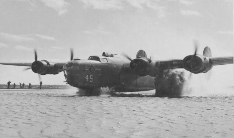 B-24 Liberator #41-11591' Lorraine' 513rd BS, 376th BG, 9th AF, flew on 1st Aug 43 Ploesti oil refinery raid piloted by William R Zimmerman, returning safely to Libya. Seen here taxiing on a badly flooded air base in Italy, April 44.