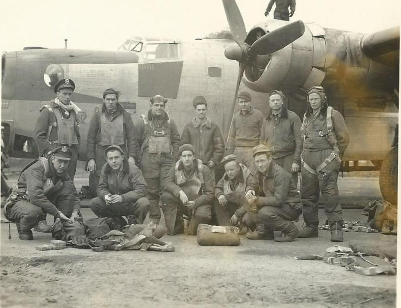 Crew #568 William K. Lee Crew 466th BG - 785th BS  Standing Left to Right:  William K. Lee (P), Ralph Wood (B), Howard W. Dallman (CP), unidentified person, S. Haupt (GC), William C. Pierce (G), Robert Moore (FE)  Kneeling Left to Right:  Raymond L. Carlson (N), William C. Baldwin (R/O), Robert R. Cointepoix (TTG), Bernard S. Boss (G), Frank Cox (TG)  This crew completed a 35 combat mission tour:  15 October 1944 - 7 April 1945