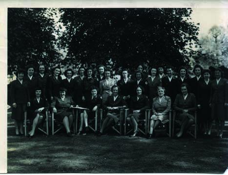 Photo taken of the American Red Cross and UK officials and directors of several of the rest homes, in the grounds of Phyllis Court, facing the river Thames, in April 1945