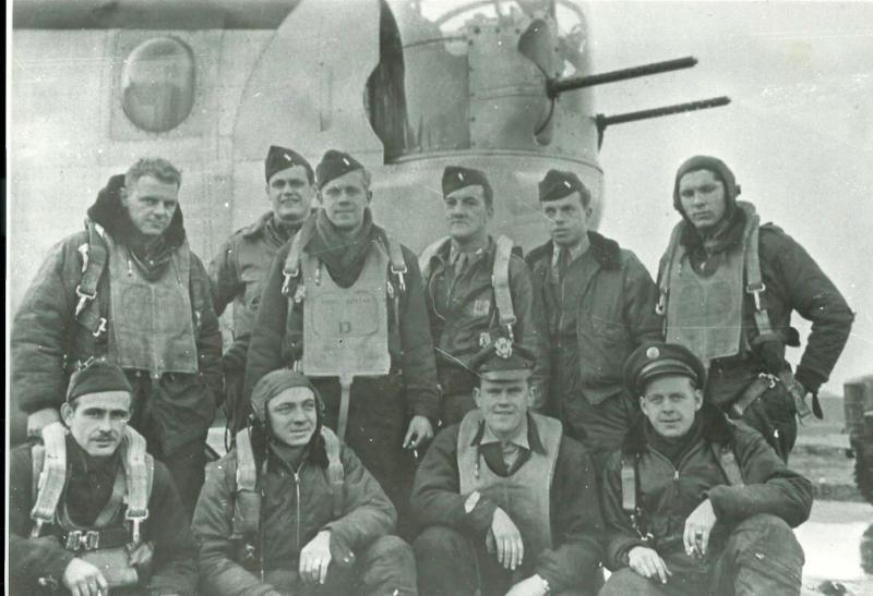 Crew #565/473 John C. Welsh Crew 466th BG - 785th and 784th Bomb Squadrons  Standing Left to Right:  Michael P. Pelish (B), Harold K. Jordon (CP), Eugene Gjertsen (RN), John C. Welsh (P), Edward W. Winter (N), Donald Dowdell (R/O)  Kneeling Left to Right:  Unidentified, Herman Young (G), Harold Westby (PN), Paul Kaufmann (TTG)  Not in photo:  John Belanger (TG), Vincent Palmer (FE)  This crew completed 7 missions with the 785th BS and then transferred to the 784th BS where they completed an additional 23 missions as a lead crew.
