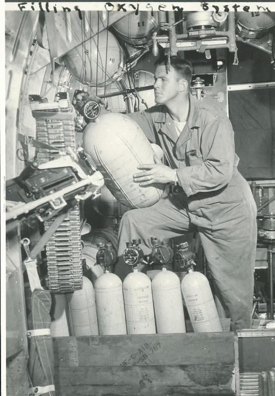 SGT Clifford Coates from Fairfield, TX filling oxygen system in a 466th BG B-24