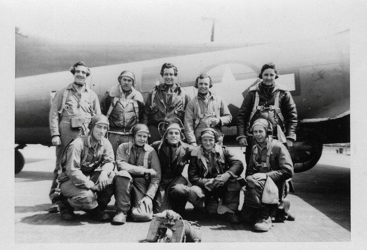 The backside (photo included in this collection) names all of the members in his squad:  William H. Marra (himself, pictured front row L to R), Mike Wojicicki, James B. Echman, Bob Mines, Bob Kincade, Ernest Fiebusch, Tom Gallagher (Pilot), James Atkinson (Bombadier), Daniel Holey Wariguton. I hope I spelled all of these names correctly. - - - - Notes from Ed Reniere 21 November 2020 : Corrected some names : It's Robert Miner (not Mines); Robert Kincaid (not Kincade); Ernst Feibusch (not Fiebusch) and Daniel Foley (not Holey). See UPL 16280 for reverse: http://www.americanairmuseum.com/media/16280