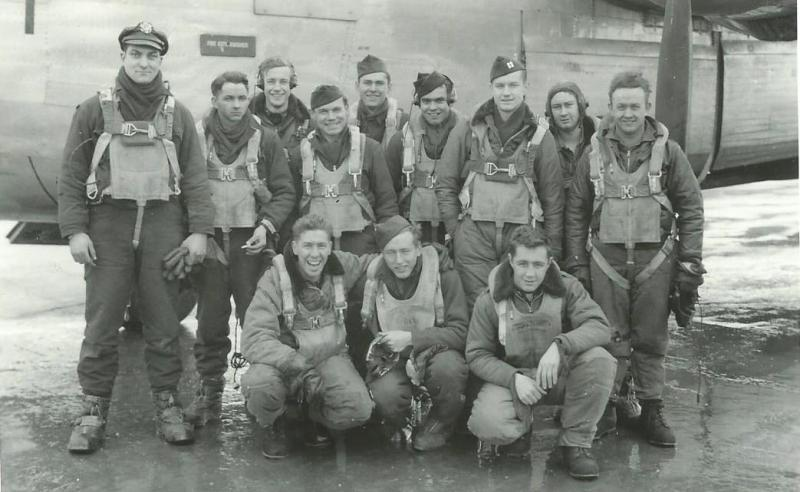 Crew #432 Everett R. Jones Crew 466th BG - 784th BS This crew transferred in from the 44th BG where they had done their lead crew training.  They flew 21 missions as a lead crew with the 466th BG.  This photo was taken on 30 December 1944 upon return from the final mission of their combat tour.  Standing Left to Right:  Robert J. Blumenfeld (B), Carton Gibbs (RN), Paul Plascke (CP), Sylvester Bauer (G), J. Taylor (G), Wayne A. Cochran (G), Everett R. Jones (P), William A. Campbell (FE), Dale G. Hapner (G)  Kneeling Left to Right:  Frank Judkovics (N), J. Purser (?), J. Taylor (Command Pilot - not from the 466th BG)