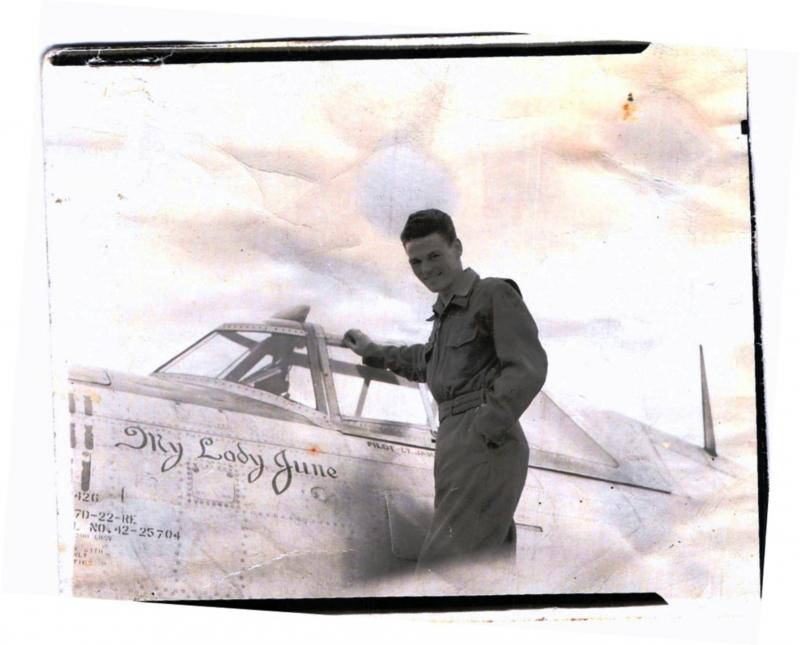 Edward M. James standing on the wing of his personal ship, 42-25704, 7J-Z,