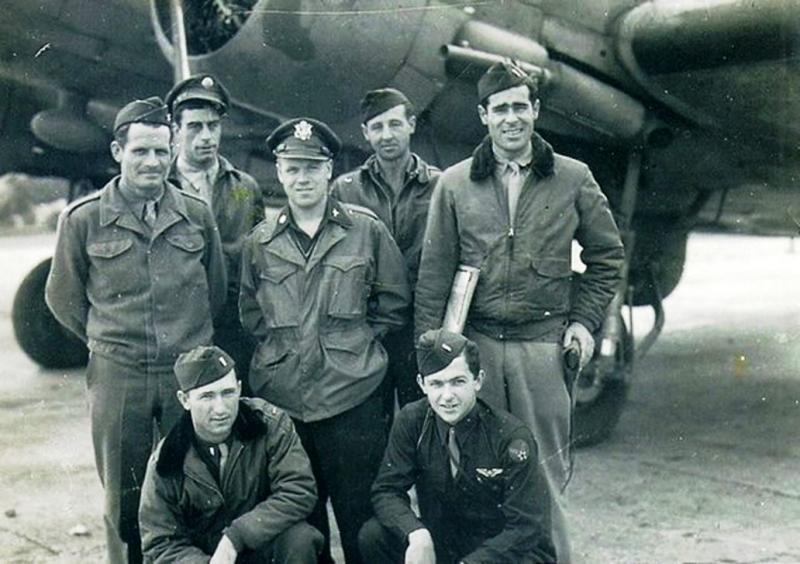 Crew pose in front of C-47 Skytrain 42-92847 'That's All Brother' of 87th Troop Carrier Squadron, 438th Troop Carrier Group, 9th AF. Lead ship of Mission Albany the air dropping of 6600 US paratroops into Normandy, France on the eve of D-Day.   Barney Blankenship (Navigator) is kneeling bottom left, John M Donalson (Pilot) is stood behind him.   The Crew who flew the aircraft on D-Day were:  Lt. Col. John M. Donalson, Command Pilot (438th Troop Carrier Group Commander)   Lt. Col. David E. Daniel, Pilot (87th Squadron Commander)   1st Lt. Barney Blankenship, Co-Pilot,  2nd Lt. John N. Shallcross, Navigator,  S.Sgt. Harry A. Chalfant, Crew Chief   2nd Lt. Robert G. Groswird, 2nd Navigator,  S.Sgt. Woodrow S. Wilson, Radio Operator (wounded by flak during the D-Day mission).