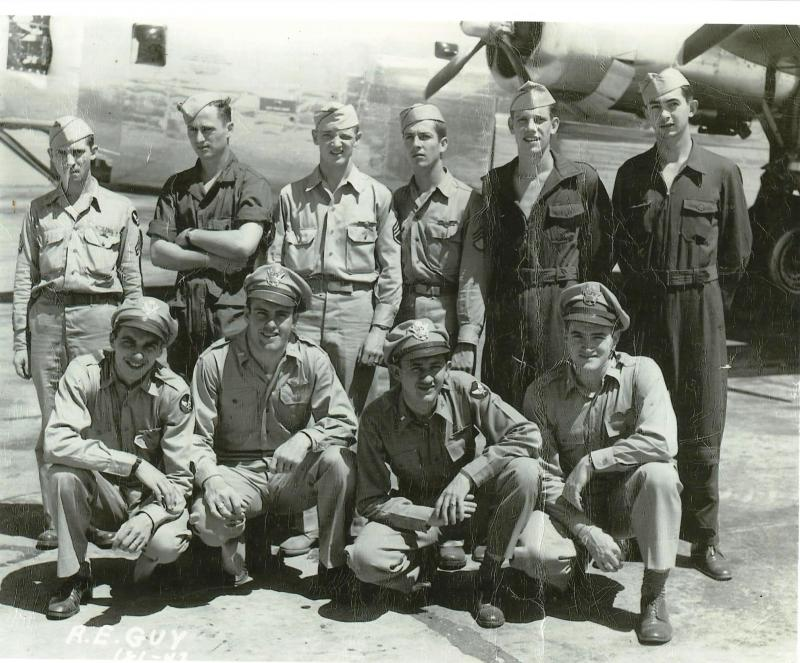 Crew #738 Roy E. Guy Crew 466th BG - 787th BS  Standing Left to Right:  Patrick Homentowski (TG), Melvin Demmin (R/O), Burl S. Garrett (FE), Russell Todd (BTG), Wayland Buchholz (WG), Marvin Creech (WG)  Kneeling Left to Right:  Ray Brasch (N), Roy Guy (P), Allen Wiedman (B), Merl Hoyle (CP)  This crew was shot down by flak on 8 September 1944.  Guy was able to affect a crash landing, which all the crew survived.  All the crew were captured and made POW.