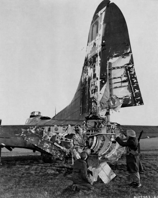 B-17 42-39867 'Hang the Expense II' sustained Flak damage on a mission to Frankfurt on 24th Jan 1944. A 88mm Flak shell exploded nearby causing the damage and also the departure from the A/C of the tail gunner S/Sgt Roy Urich. Urich was wounded but miraculously survived to become a POW. With a new tail section fitted the A/C returned to Ops renamed to 'Boeing Belle'. Seen here on the ground at RAF Eastchurch, Kent, UK. Witnesses on board swear he flew through the air still in his seat and hanging on to Browning gun handles !!
