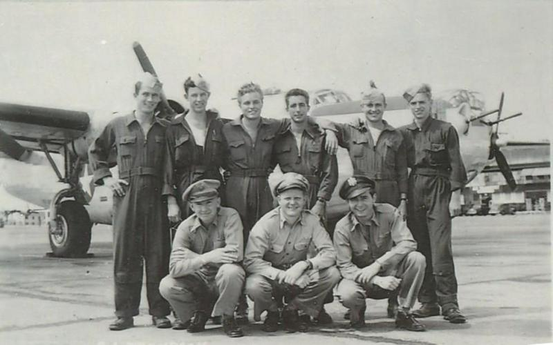 Crew #750 Russell A. Thompson Crew  Standing Left to Right:  Judson V. Braselton (WG), Robert L. Wiseman (FE), Harold C. Boles (G), Bernard E. Weigel (R/O), Paul A. Salness (G)  Kneeling Left to Right:  Russell A. Thompson (P), Kennard Underwood (N), James A. Hufnagel (B)  Missing from photo:  Allen L. Gessing (CP), Angelo A. Taranto (G)  This crew completed a 35 combat mission tour:  25 August 1944 - 2 March 1945