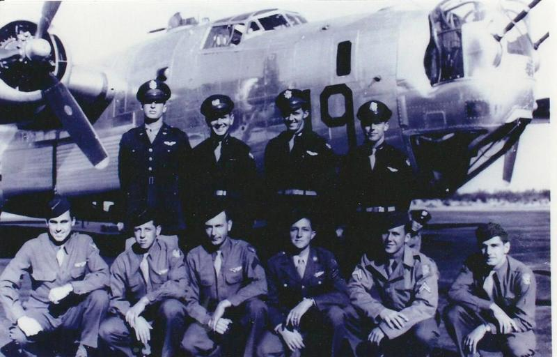 Crew #784 Charles A. Felts Crew 466th BG - 787th BS  Standing Left to Right:  Charles Dondes (N), Edmond Cody Hall (CP), Charles A. Felts (P), Edwin N. Kimmel (B)  Kneeling Left to Right:  Edward J. Weidner (WG), Martin Tarlosky (NG), Merritt W. McLaughlin (FE), Clinton E. Swanson (TG), Harry J. Bender (WG), Marvin Allard (R/O)  The man peering out from behind the nose wheel is not identified.  This crew completed 17 combat missions before hostilities ended.  The tour included being shot down and bailing out over Allied held Valkenburg, Netherlands on 12 March 1945.  All the crew safely parachuted and returned to combat.