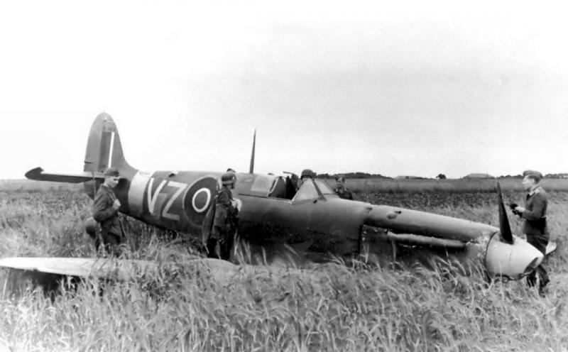 Supermarine Spitfire Mk Vb BL964 having been pancaked by Lt Col Albert P Clark XO 31st FG whilst on familiarisation flight in ETO [412 Sqn RCAF] shot down by JG26 Fw190 over Abbeville.