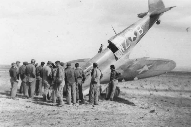 Supermarine Spitfire Mk Vb [T] EP971 WZ-B, 309th FS, 31st Fighter Group  stands on its nose after a landing accident in Algeria, Africa 1943.