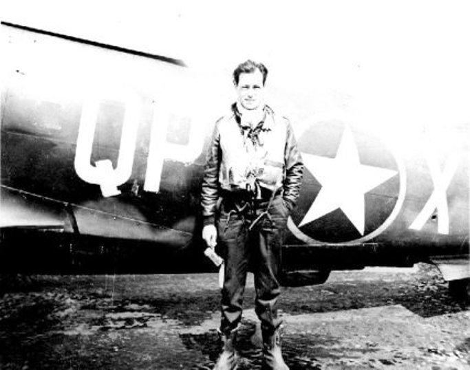 1st Lt Stanley Anderson 334th FS, 4th FG, 8th AF USAAF a former 71 Eagle Sqn RAF P/O. Poses in front of P-47 42-8644 QP-X