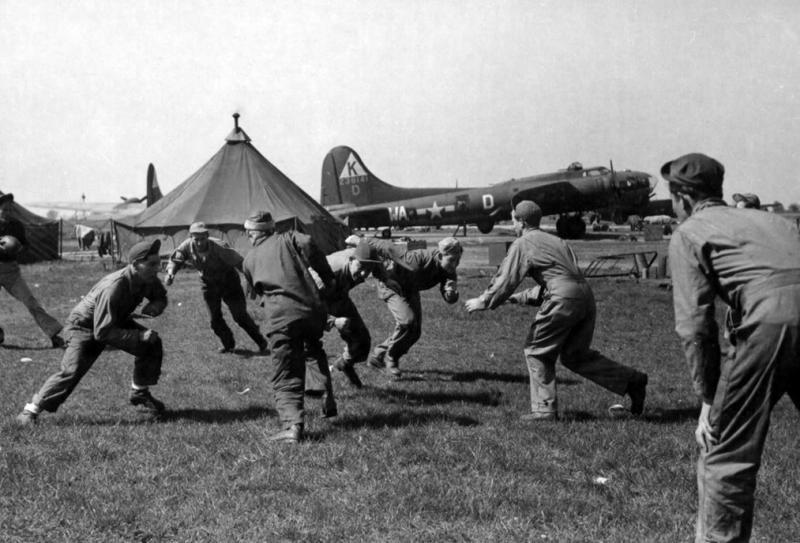During off duty hours members of the 379th Bomb Group participate in a spirited game of football at an 8th Air Force Base in England, 20 April 1944.  All named and Identified are Ground Crewmen/Personnel of