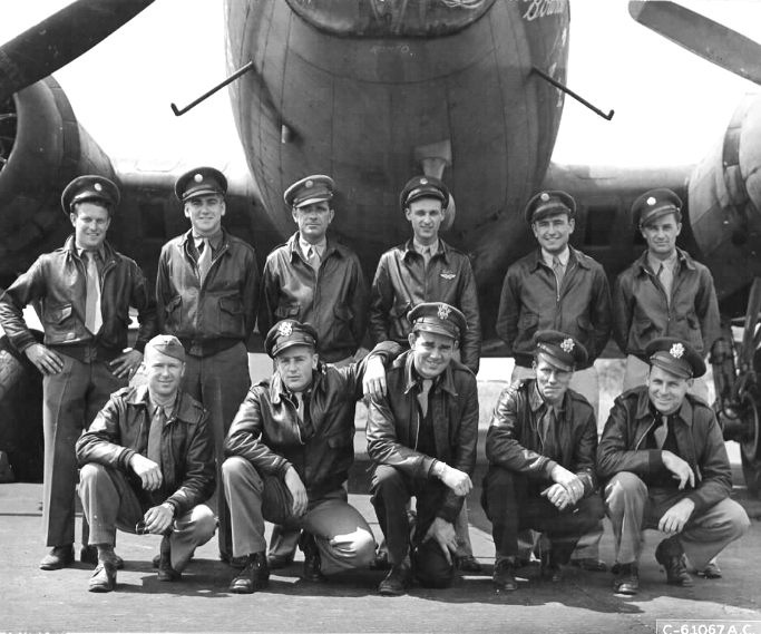 """Photo of Lt Ripley W. Joy's crew in front of """"Jersey Bounce"""", Serial #41-24539, Molesworth 27 July 1943. Back row, left to right : S/Sgt David Miller; S/Sgt Alfred R. Buinicky; S/Sgt Walter Gasser; S/Sgt James H. Comer Jr; S/Sgt Marion D. Ignaczewski; S/Sgt Frank Kimotek Front row, left to right : Lt Ripley W. Joy; Lt William J. Monahan; Lt William P. Maher; Lt Walter Hargrove; Lt Martin L. Clark."""