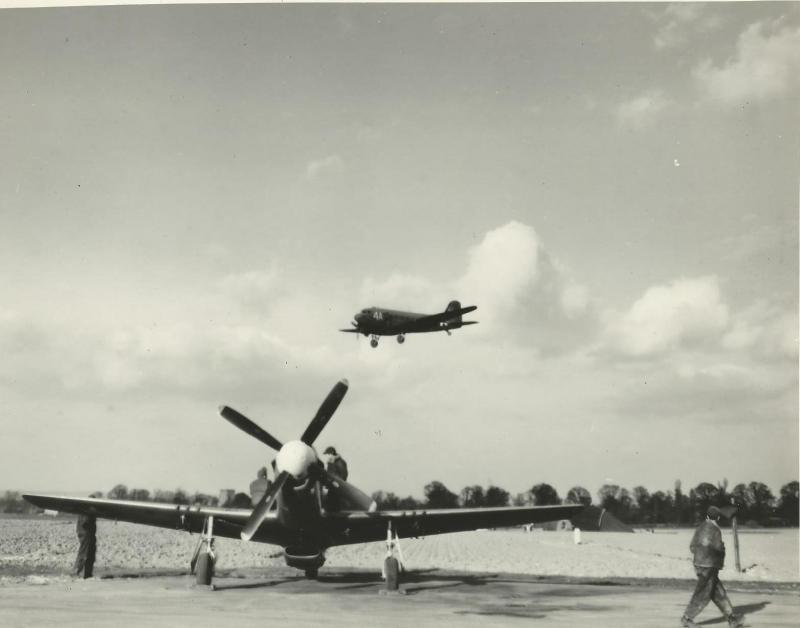 C-47 of the 315th TCG - 310th TCS coming into land with a P-51D in the foreground.  Possible at Attlebridge