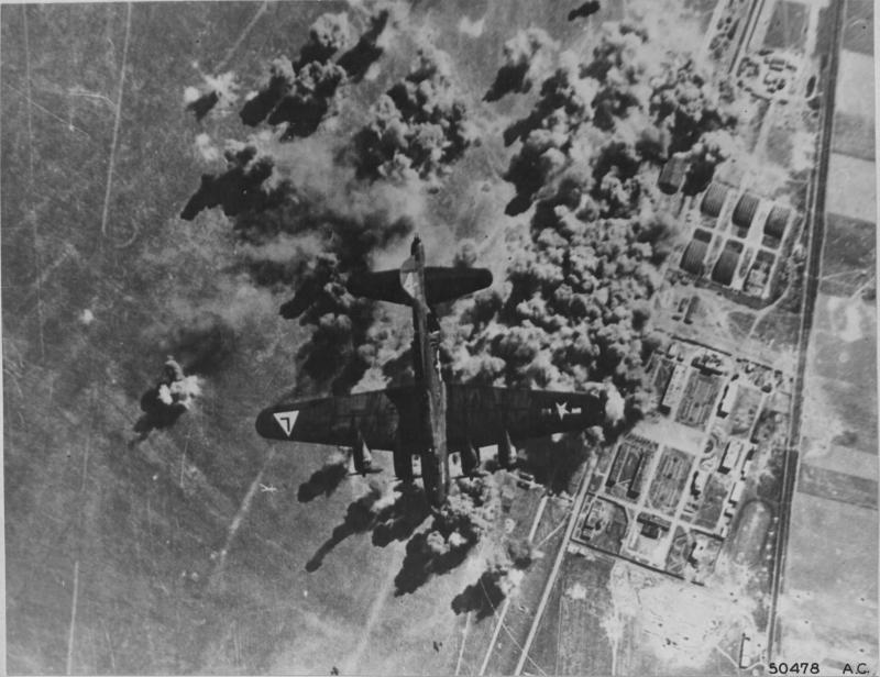 A crippled Flying Fortress silhouetted over the target at the Reims Champagne Airfield, France which the 8th AF