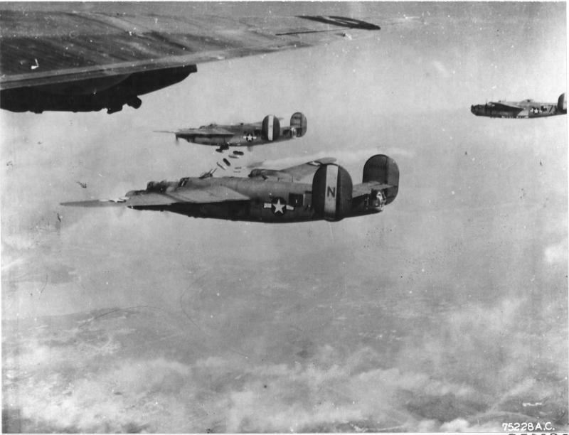 Consolidated B-24 Liberators drop their bombs on enemy installations at Royan, France. 15 April 1945. NARA Ref No. - 342-FH-3A19153-75228AC.  Centre of picture is B-24 41-29340 'Yankee Buzz Bomb' 458th BG.