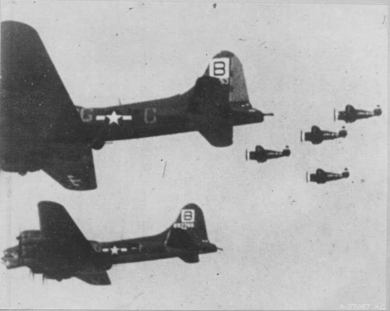 P-47 Thunderbolts of the 56th FG troll by a flight of 95th BG Fortresses in a still image from the AAF motion picture,