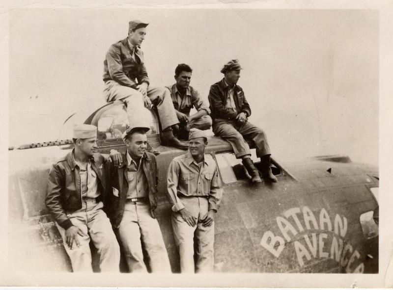Joseph Jordan, tailgunner, is sitting on top of the turret.  This was taken soon after the St. Etienne mission on May 25, 1944, where the aircraft was listed as missing, when they actually had suffered severe damage and diverted to Corsica.  The people in the photograph are those that were not lost on this raid.  On the back of the photo are the names of the survivors.