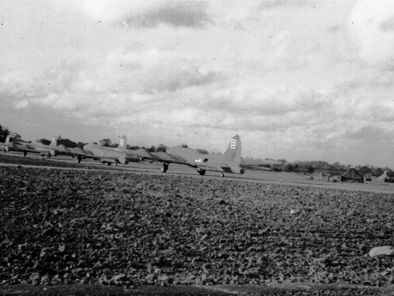 Flying Fortresses of the 412th BS, 95th BG, 8AF USAAF taxiing to the runway. 42-30634 'Liberty Belle' the last in the file.
