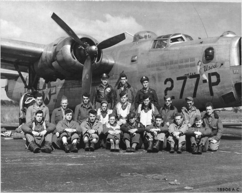 Crew members of the 458th Bomb Group pose beside a Consolidated B-24 at an 8th Air Force Base somewhere in England. - B-24JAZ-155-CO Liberator 44-40277 named