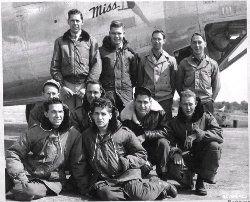 Crew members of the 753rd Bomb Squadron, 458th Bomb Group, pose beside a Consolidated B-24 somewhere in England. 13 November 1944. B-24JAZ-155-CO Liberator 44-40277