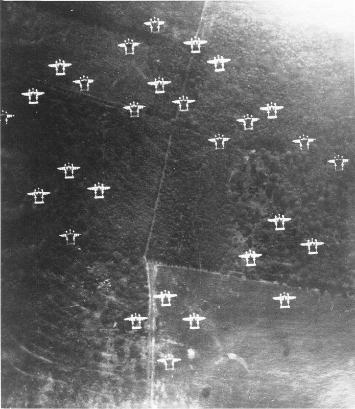 Lockheed P-38J Lightning 'Droop Snoot*' 42-67450 LC-E 'Eze Doe's It' 77th FS, 20th FG, 8th AF USAAF. 'Eze Does It' is at the front of this formation.  'The 20th Fighter Group were also assigned a P-38J Droopsnoot aircraft where the armament was replaced with a glass nose and bombsight and a bombardier rode in the nose. The other aircraft would fly in close formation with the droopsnoot and all drop their bombs when the lead aircraft released its. Several missions were flown using this technique in the build up to D-Day. These missions weren't popular with the pilots who didn't like flying straight and level in close formation over enemy targets!'