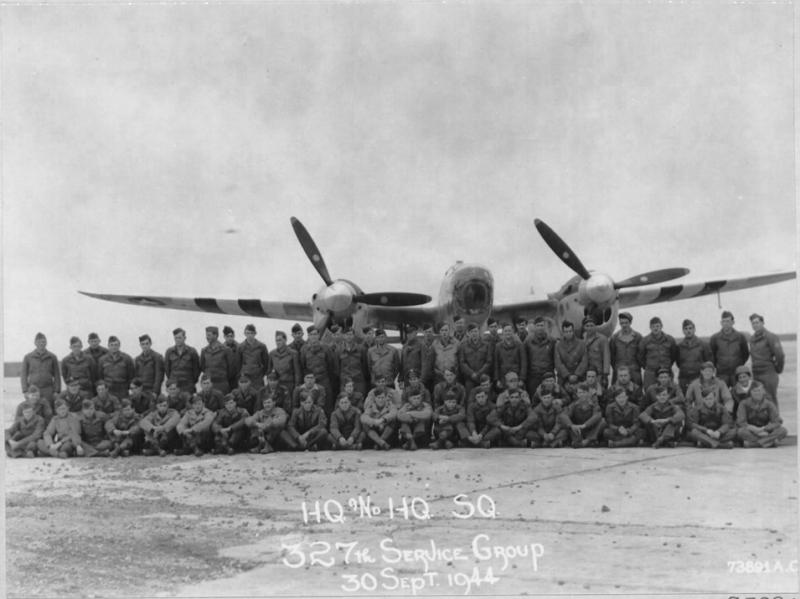 Personnel of HQ and HQ Sqn of the 327th service group, pose for the photographer at an air base in France, 30 September 1944: Personnel of the 327th Service Squadron pose in front of