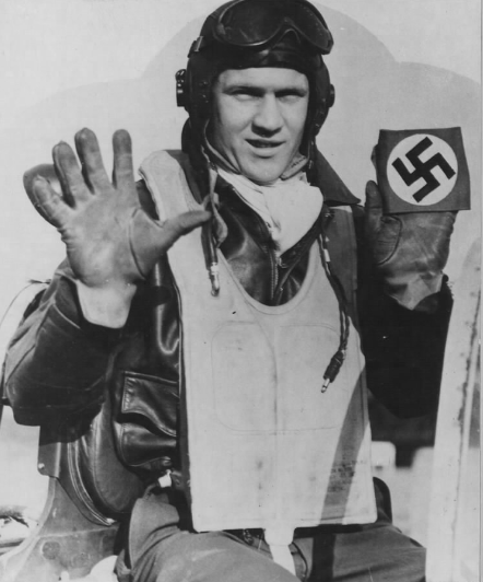 "Official USAAF photo. Original caption : ""Rated as the leading U.S. fighter ace still active in European battle skies, Capt. Ray S. Wetmore, 22-year-old North American P-51 Mustang flight commander, of Kerman, Calif.  now has a total bag of 21½ Nazi planes destroyed as well as 3-1/3 on the ground. Above he records his score of four enemy fighters destroyed and a share in the blasting of a fifth during his latest dog-fight near Dimmer Lake, Germany. The swastika is of the same design as the 24 his ground crew have painted on his Mustang, ""Daddy's Girl"", named after his eight-month-old daughter. His wife, Mrs. Carmelina Wetmore and daughter live in Roslyn, N.Y."""