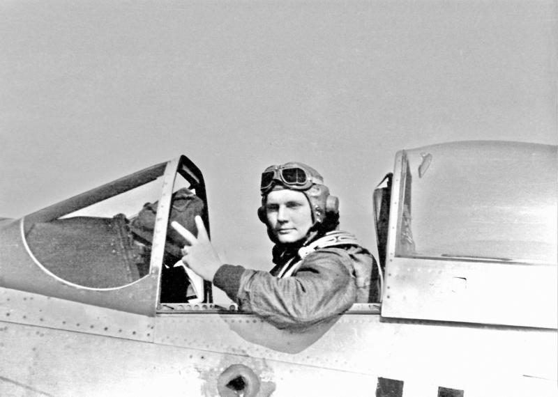 1st Lt. James A Bateman in the cockpit of his P-51D Mustang.