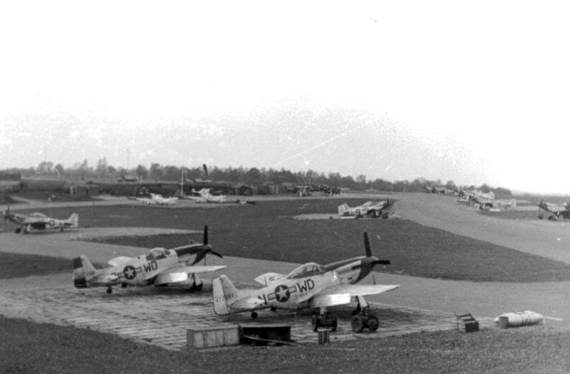 P-51's of 335th Fighter Squadron in their dispersal area. In the foreground is P-51D 44-72061 WD-N with next to it a war-weary P-51B 43-6570 WD-3