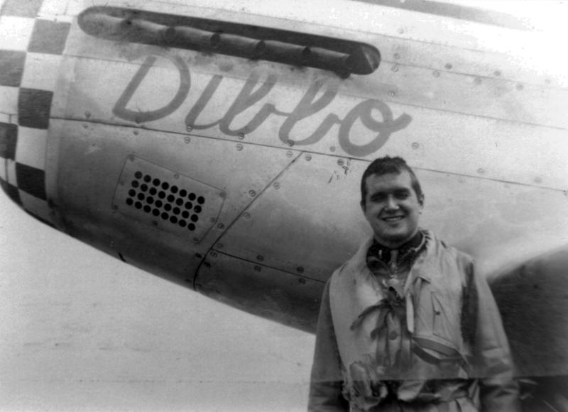 Capt. Owen P Farmer Jr of Fort Scott, Kansas stands by one of his assigned P-51 Mustangs. An original cadre pilot, Capt Farmer had five known P-51s assigned to him, all of which were coded 6N-H and named