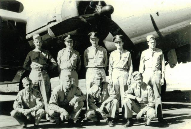 Roy Island Crew 388th BG - 562nd BS  Standing Left to Right:  Robert L. Sanders (FE), Robert A. Palmer (B), Roy E. Island (P), John P. Gallien (CP), Oliver A. Morris (WG)  Kneeling Left to Right:  Larry C. Parrish (R/O), Henry G. Woods (TG), Fred L. Brunty (WG), Woodrow W. Wiggins (BTG)  Completed 27 mission tour:  26 November 1943 - 16 March 1944