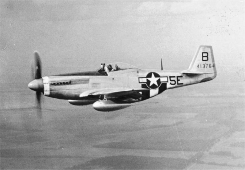 1st Scouting Force P-51D 44-13764 5E-B. Pilot is Phil Algar on his way to Grafton Underwood for the 200th mission party of his old unit the 384th BG. This a/c was lost on 15 February 1945 with F/O Irvin E Lang being killed in action.