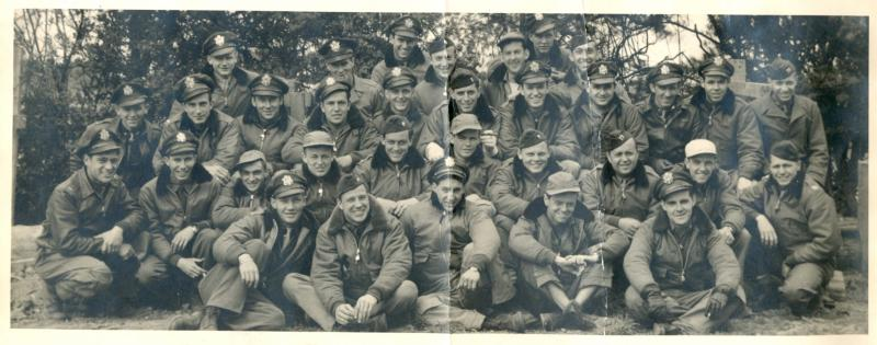 From William E Peto: 'I have enclosed a photo of the [36th Fighter Group's] 53rd Fighter Squadron personnel as constituted in March - April of 1944 at Ashford Kent. On the back is a list of those in the picture, left to right, front row to top row. The Flight Surgeon Captain Kaufman, Ground Officers Major Thomas and Lieutenant Hurley are listed.'  'As we became operational I noted those were KIA or MIA. Major Deabler seated next to me, who was our CO, was shot down on his second mission. I was more fortunate. I flew 90 missions and survived a parachute jump and returned to the States at the end of March 1945 as one of the three remaining from the original group (Hodge and Haugen). At the time I was Operations Officer.'  Front row, left to right: E Obie, Al Garner, Cooper,