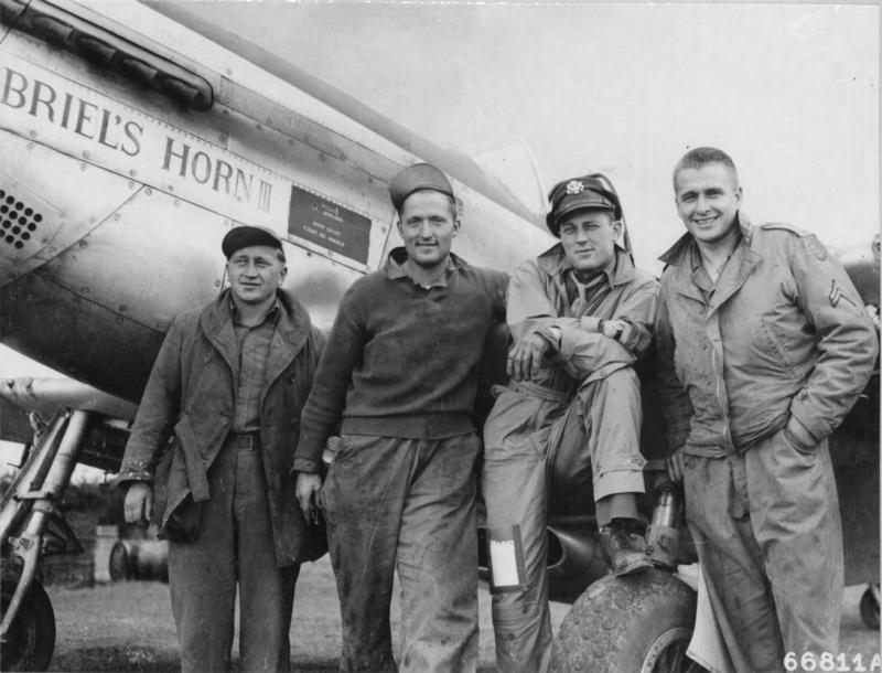 Lt Arthaud, pilot of the North American P-51D Mustang 'Gabriel's Horn III', crew chief T/Sgt Mcdonald and other ground crew beside the plane of the 20th Fighter Group.  NARA Ref 342-FH-3A12265-66811AC