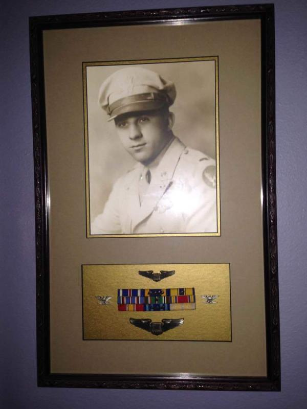 Photo, bombardier wings, rank insignia and medal ribbons of Lieutenant Colonel Dominic P Maineiri.