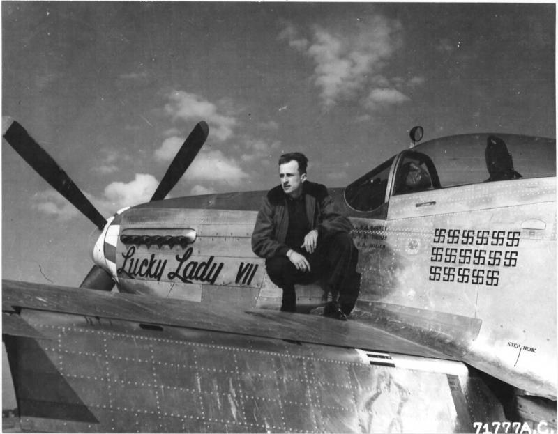 Major Ernest E Bankey of the 364th Fighter Group, 67th Fighter Wing, poses on the wing of his North American P-51 'Lucky Lady VII' P-51D 44-73045, coded 5E-B at an 8th air force base in England. 23 March 1945.  NARA Ref 342-FH-3A12352-71777AC