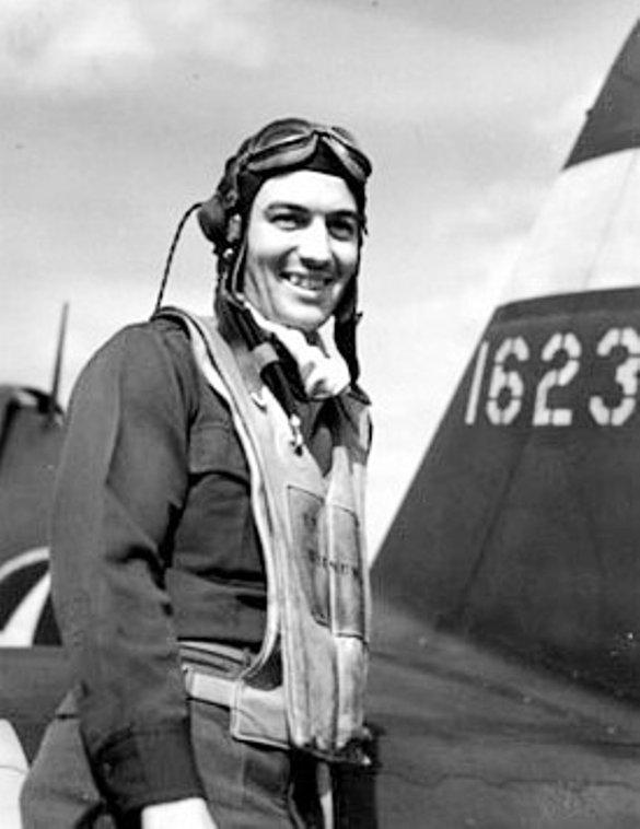 Capt Eugene E Barnum Jr - 61FS, 56FG, 8AF.  Standing in front of P-47C 41-6232, 6233 or 6237 all of which were 61FS aircraft.