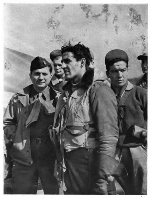Captain Don Gentile (center) of the 4th Fighter Group after a mission. War Correspondent Ira Wolfert, who spent almost a month getting Gentile's story, is at the far left of the picture.