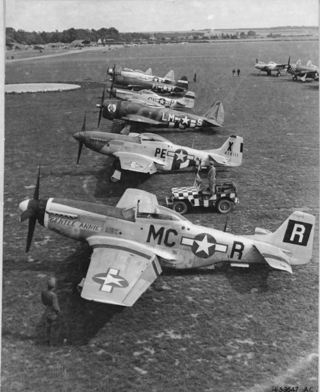 All three fighter types used by the U.S. Army 8th Air force are seen in this line-up of Fighter Command airplanes at a base in England. The planes belong to the fighter group commanders who have flown to an agreed meeting place where they and their chief Brig Gen Francis H Griswold,  can confer on ways of troubling the tottering German armies and air force. Taken at Bottisham, Camb, UK.  F-R: 44-14337
