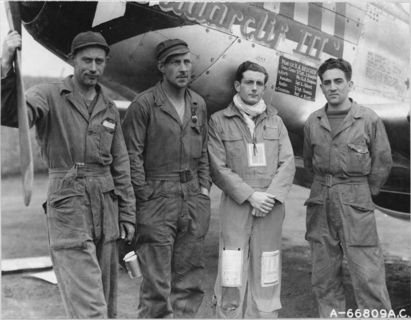 Lt. Darrell A Beschen, pilot and ground crew beside the North American P-51D Mustang 'Wildarclif III' of the 20th Fighter Group In England. Ground crew are likely C/C S/Sgt James A Douglas, Asst C/C Cpl George A Fregone and Armourer Sgt Luther W Ghent.  NARA Ref 342-FH-3A12260-A66809AC.