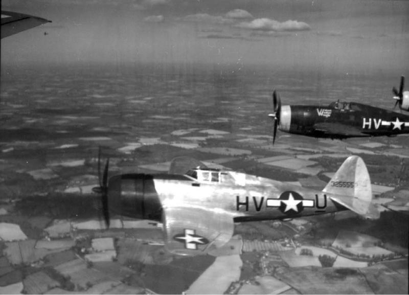 """P-47D 43-25555 HV-U_. Shadow on nose is from the photo-ship, and flying wing is Lt. Robert J Rankin's 42-74622 HV-H """"Wicked Wacker Weegie"""". 61st Fighter Squadron 56th Fighter Group.."""